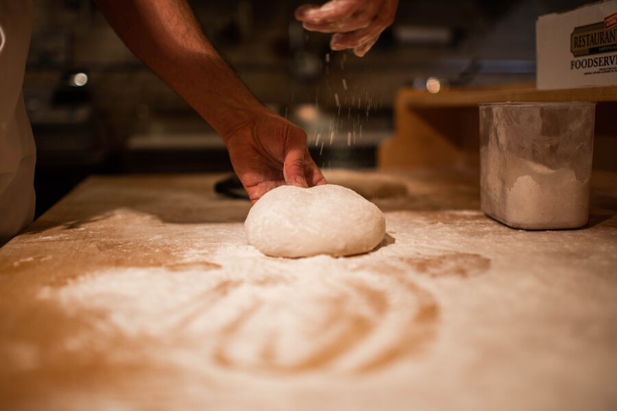 bread dough resting on floured table